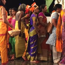 SWAMI MINGLES WITH DANCERS